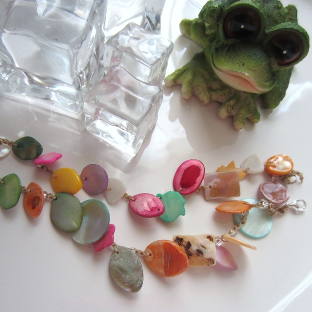 Beautiful, colorful shell beads, crocheted into a pair of bracelets.