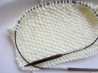 Knit with size 9 needles, a little bit larger than recommended.