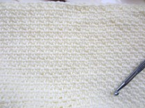 Crochet with a size K hook. Larger than recommended because I like the drape much more.
