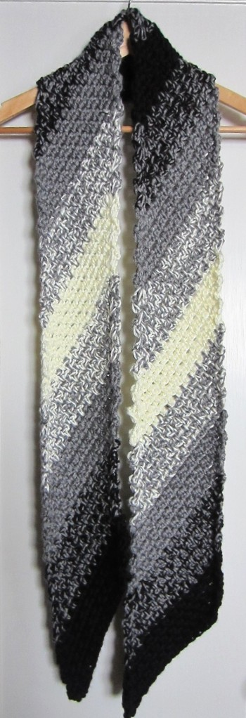 Seed Stitch on the diagonal.  Simply Soft yarn, two strands held together.