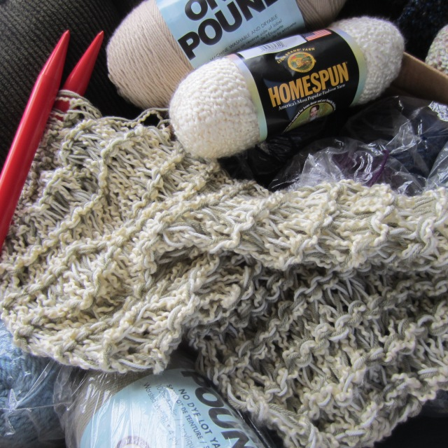 Here you can kind of see the knitting needles I am using.  Size 50!  I think 3 skeins held together is enough for a nice scarf.