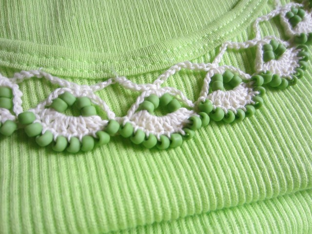 I strategically tacked the motifs in place all around the neckline.