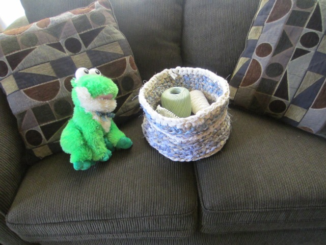 Sharing the love seat with my little froggy friend.  He croaks nursery rhyme songs.  :D